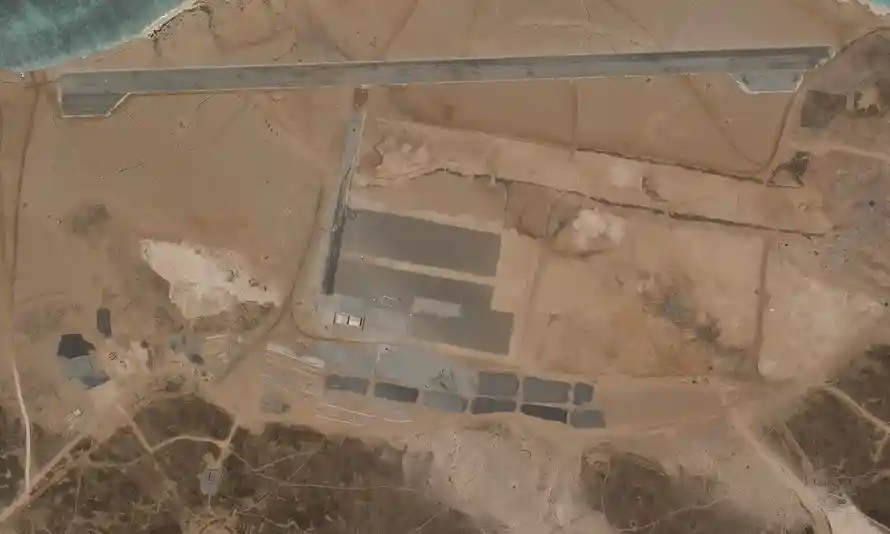Which country has the mysterious air base in the Bab el-Mandeb Strait?